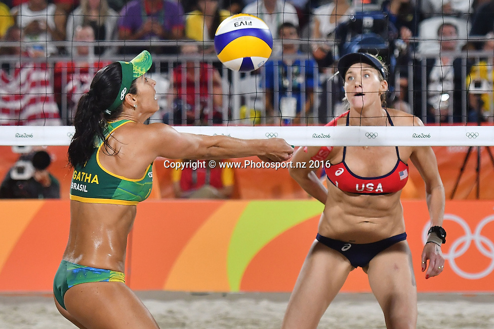 Brazil's Agatha Bednarczuk-Rippel (L digs the ball watched by USA's Kerri Walsh-Jennings during the Women's beach Volleyball semifinal in the volleyball arena on Copacabana beach at the 2016 Rio Olympics on Wednesday the 17th of August 2016. © Copyright Photo by Marty Melville / www.Photosport.nz