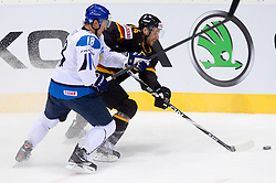 Sami Lepisto of Finland vs Andre Rankel of Germany during ice-hockey match between Germany and Finland of Group E in Qualifying Round of IIHF 2011 World Championship Slovakia, on May 6, 2011 in Orange Arena, Bratislava, Slovakia. Finland defeated Germany 5-4 after overtime and shootout. (Photo By Vid Ponikvar / Sportida.com)