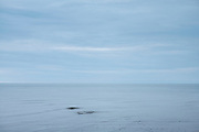 Waves in calm sea at Aberaeron in Cardigan Bay, Pembrokeshire coastline, Wales, UK
