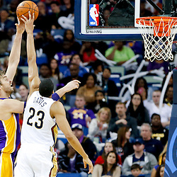 Nov 8, 2013; New Orleans, LA, USA;  New Orleans Pelicans power forward Anthony Davis (23) blocks a shot by Los Angeles Lakers center Pau Gasol (16) during the second quarter of a game at New Orleans Arena. Mandatory Credit: Derick E. Hingle-USA TODAY Sports