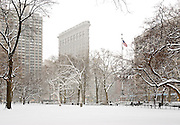 The Flatiron Building in Winter as seen from Madison Square Park, Manhattan, New York City.