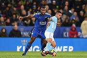 Manchester City striker Gabriel Jesus (33) holds off Leicester City defender Wes Morgan (5) during the Premier League match between Leicester City and Manchester City at the King Power Stadium, Leicester, England on 18 November 2017. Photo by Jon Hobley.