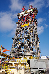 Stock photo of twin derricks featured on a deepwater offshore oil and gas drilling rig.