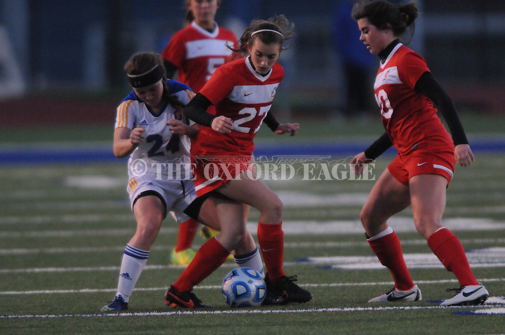 Oxford High's Ally Shinall (24) vs. Lafayette High's Rachel Watkins (27) in girls high school soccer, in Oxford, Miss. on Tuesday, December 9, 2014. Lafayette High won 3-2.