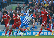 Brighton striker Tomer Hemed turns away from Cardiff City midfielder Kagisho Dikgacoi during the Sky Bet Championship match between Brighton and Hove Albion and Cardiff City at the American Express Community Stadium, Brighton and Hove, England on 3 October 2015. Photo by Bennett Dean.