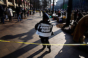 The Inauguration of President Barack Obama. Washington DC, January 20, 2009. Along the Parade Route. A young protestor in a roped-off area.