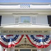 A New England Public Library decorated with red, whit and blue banners for the Fourth of July celebraation. Ellsworth, Maine
