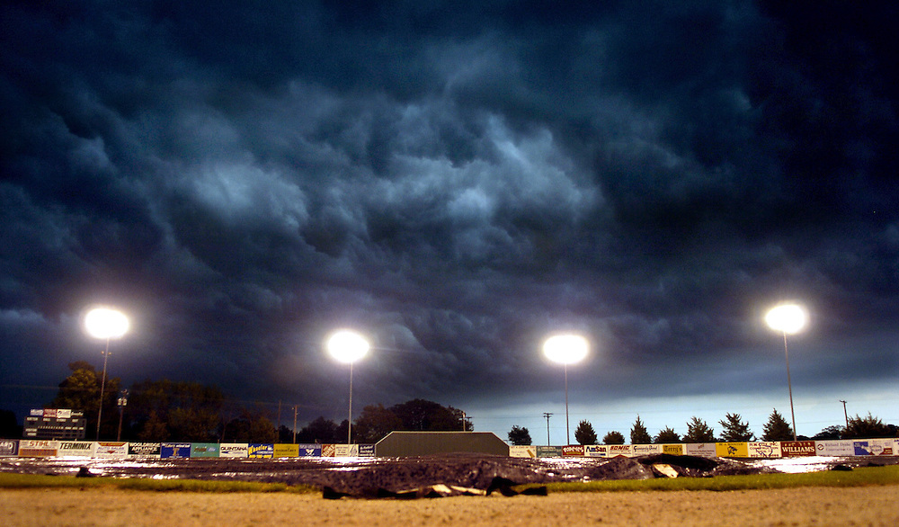 Dark clouds roll over Cecil B. Pos Long Field in Paris, Texas, cancelling a high school baseball game as strong thunder storms blew into North East Texas on Tuesday April 5, 2005..