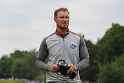 Chris Wood finishes the 18th hole during the BMW PGA Championship at Wentworth Club, Virginia Water, United Kingdom on 29 May 2016. Photo by Phil Duncan.