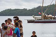 homecoming greeting for Aunofo, crew member on traditional double-hulled Polynesian voyaging canoe or waka, Hine Moana, at Hunga Village, Hunga Island, Vava'u, Kingdom of Tonga, South Pacific