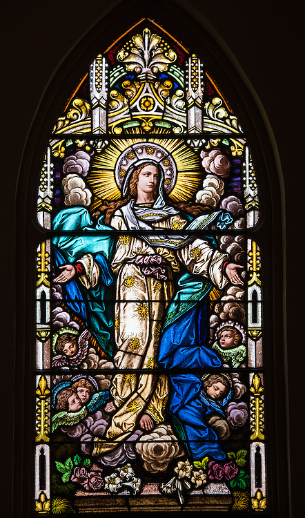 Stained glass window at St. Mary Church in Bear Creek, Wis., depicts Mary's assumption into heaven. (Sam Lucero photo)