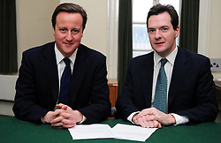 Leader of the Conservative Party David Cameron with George Osborne.Member of Parliament for Tatton in his office in Norman Shaw South, January 18, 2010. Photo By Andrew Parsons / i-Images.