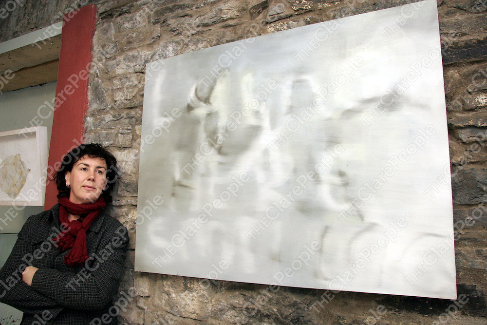 Organiser Jackie Askew with her piece titled 'Text' at the opening night of the Hidden Depths art exhibition in Ennistymon on Wednesday night.<br />