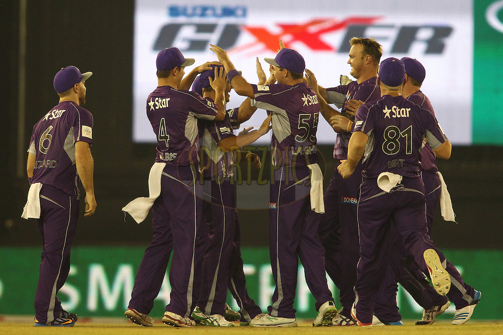 Cameron Boyce of the Hobart Hurricanes is congratulated for taking the catch to get Virender Sehwag of the Kings XI Punjab wicket off the first ball of the innings during match 2 of the Oppo Champions League Twenty20 between the Kings XI Punjab and the Hobart Hurricanes held at the Punjab Cricket Association Stadium, Mohali, India on the 18th September 2014<br /> <br /> Photo by:  Shaun Roy / Sportzpics/ CLT20<br /> <br /> <br /> Image use is subject to the terms and conditions as laid out by the BCCI/ CLT20.  The terms and conditions can be downloaded here:<br /> <br /> http://sportzpics.photoshelter.com/gallery/CLT20-Image-Terms-and-Conditions-2014/G0000IfNJn535VPU/C0000QhhKadWcjYs