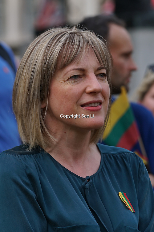 London,England,UK, 6th July 2016 : Lithuania Ministry of Foreign Affairs Asta Skaisgiryte (R)celebration Lithuania's National Day is a day Lithuanian State first crown King in the 13th Century singing national anthem at Parliament square, London. Photo by See Li