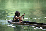 Scene of a man in prehistoric times rowing with an oar in a canoe made from a hollowed out tree trunk. Image taken from the filming of 'Paris la ville a remonter le temps' written by Carlo de Boutiny and Alain Zenou, directed by Xavier Lefebvre, a Gedeon Programmes production. Picture by Manuel Cohen