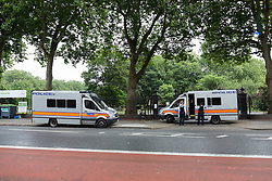 © Licensed to London News Pictures. 22/07/2016. LONDON, UK.  Police officers and police vans at the entrance of West Ham Lane Recreational Ground, known as Stratford Park on West Ham Lane in Stratford, where a man in his 20's was stabbed and killed yesterday afternoon. Two men were arrested nearby on suspicion of murder and taken into custody at an east London police station. Photo credit: Vickie Flores/LNP