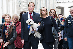 © Licensed to London News Pictures. 25/01/2018. LONDON, UK.  IMAGE DATED 20/02/17. Gabby (Gabrielle) and Florian Kuehn with Vinnie the dog, supporters and their dogs arriving at the Mayor's and City of London court in London on 20th February 2017. Today, 25th January 2018, an appeal hearing at the High Court has been brought by the Kuehn's against the blanket no pet policy clause in the leasehold agreement issued by their property management company, Victory Place. The appeal follows a previous hearing at the Mayor's and City of London magistrates court held in February 2017 when Victory Place Management Company brought and won an action to evict the couples dog, Vinnie, a Maltese-Yorkshire terrier cross. The Kuehn's have appealed against the original judgement and are challenging the legality of blanket no pet policies in leasehold contracts. Victory Place Management Company have lodged a counter appeal. Photo credit: Vickie Flores/LNP