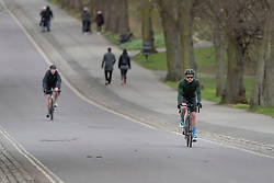 © Licensed to London News Pictures. 29/03/2020. London, UK. Members of the public exercise in Greenwich Park in South East London . The Government has announced a lockdown to slow the spread of Coronavirus and reduce pressure on the NHS. Photo credit: George Cracknell Wright/LNP