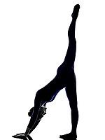 woman exercising Adho Mukha Svanasana Downward Facing Dog pose yoga silhouette shadow white background
