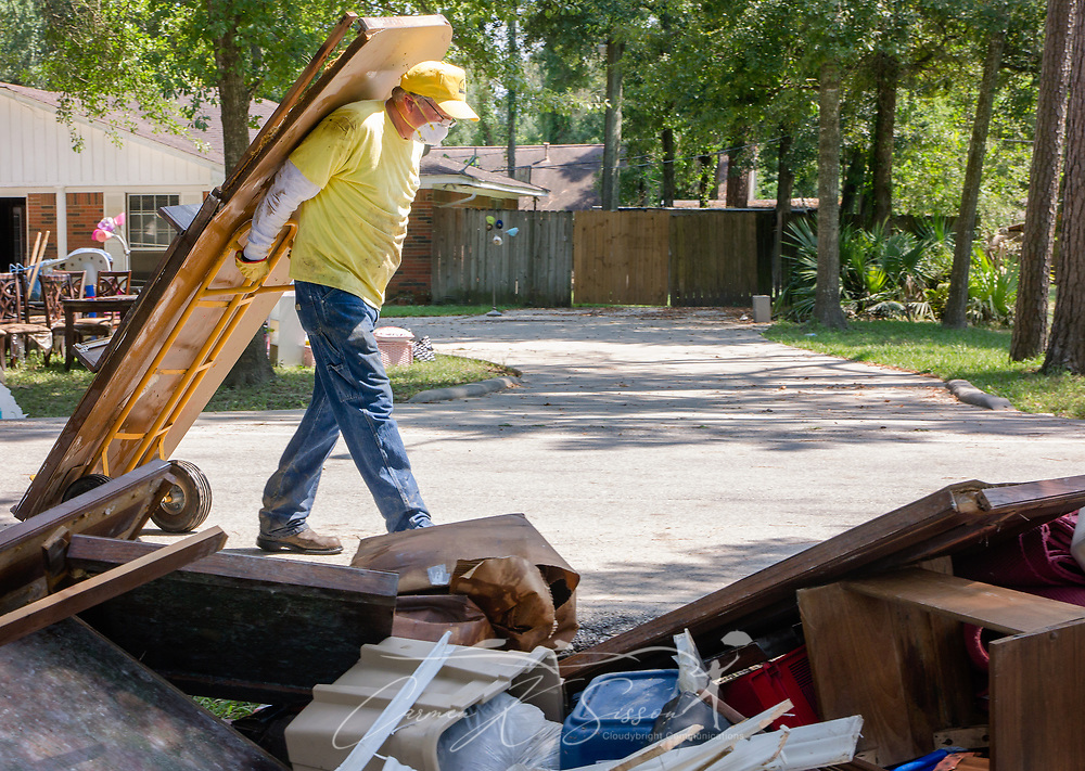 Southern Baptist Disaster Relief volunteer Neal Allison, of Central Baptist Church in Thornton, Texas; carries a flood-damaged door to a debris pile, Sept. 6, 2017, in Houston, Texas. Homeowner Paul Matlock's home was inundated with more than six feet of water when Hurricane Harvey dumped more than 51 inches of rainfall in mid-August. Approximately 70 people died in the U.S. due to the hurricane and flooding, but that number is expected to rise as water levels fall, allowing rescuers to reach more areas. (Photo by Carmen K. Sisson)