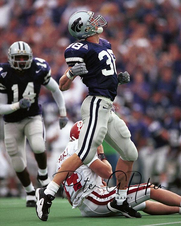Kansas State defensive back John McGraw (38) celebrates after sacking Oklahoma quarterback Josh Heupel during game action against the Sooners at KSU Stadium in Manhattan, Kansas in 2001.