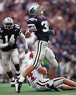 Kansas State defensive back John McGraw (38) celebrates after sacking Oklahoma quarterback Josh Heupel during game action against the Sooners at KSU Stadium in Manhattan, Kansas in 2001.