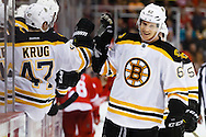 Apr 2, 2015; Detroit, MI, USA; Boston Bruins defenseman Zach Trotman (62) receives congratulations from teammates after scoring in the third period against the Detroit Red Wings at Joe Louis Arena. Boston won 3-2. Mandatory Credit: Rick Osentoski-USA TODAY Sports
