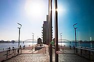 Europa, Deutschland, Koeln, im Rheinauhafen, die Promenade an der Agrippinawerft und die Suedruecke spiegeln sich in einem Fenster.<br /><br />Europe, Germany, Cologne, the Rheinau harbour, the promenade at the Agrippinawerft and the South bridge reflected in a window.