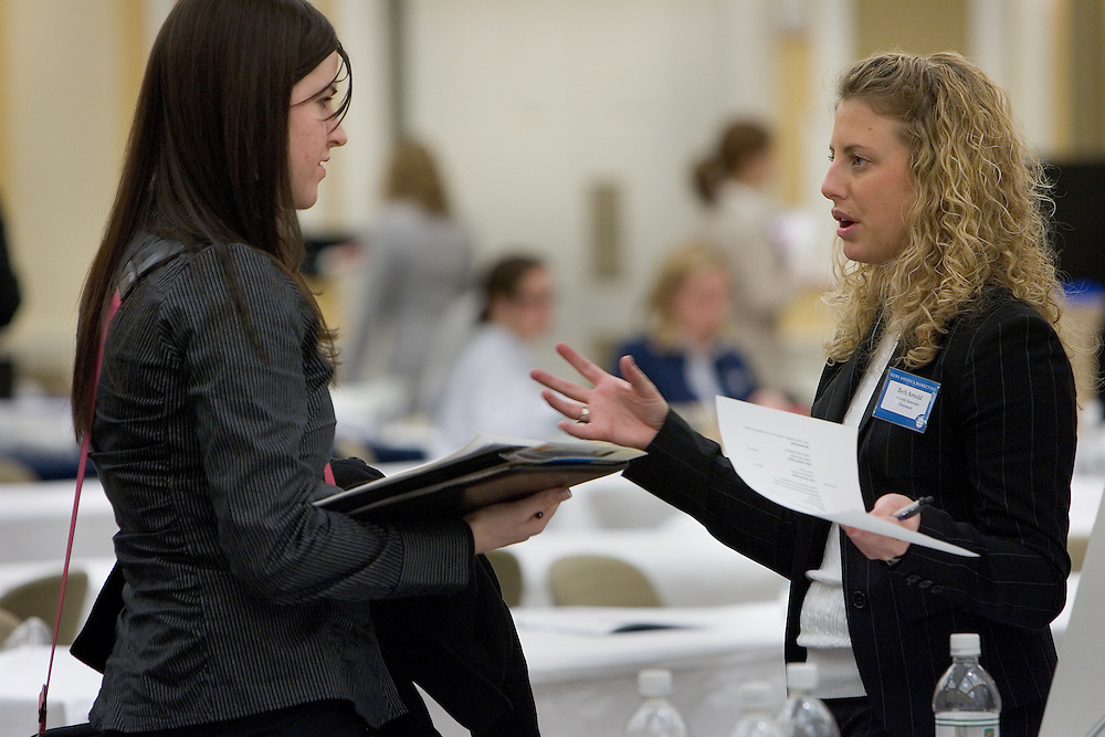 Student Deborah Shelor (left) talks with Beth Arnold of News American Marketing during the Job Fair in the Baker Center ballroom on Monday 2/5/07.