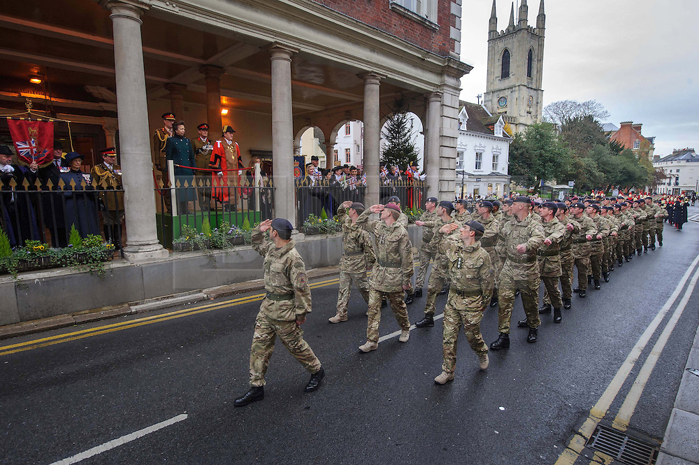 &copy; Licensed to London News Pictures. 04/12/2013 Windsor, UK. <br /> Soldiers of the Household Cavalry march through the streets of Windsor to mark the Regiment&rsquo;s sixth and final return from Afghanistan. HRH The Princess Royal took the salute outside Windsor's historic Guildhall. Photo credit : Simon Jacobs/LNP
