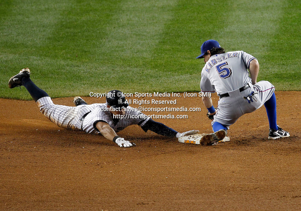 New York Yankees third baseman Alex Rodriguez (13) steals second behind Texas Rangers second baseman Ian Kinsler (5) in game 5 of the ALCS at Yankee Stadium in New York, October 20 2010.