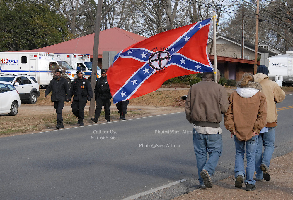 "A group of white supremits carrying a flag that read "" white power -knights of the ku klux klan"" walk by a group of Black Panthers after a rally on Martin Luther King Day in Jena Louisiana Jan, 21, 2008. A group of protesters march to Jena High School on the Martin Luther King Jr. holiday in Jena, La., Monday, Jan. 21, 2008. The protest was organized by the self-described 'pro-majority' Nationalist Movement of Learned, Mississippi, lead by Richard Barrett, and was being held in opposition to the six black teenagers who were arrested in the beating of a white classmate in December 2006, and the King holiday. The protest drew about 50 participants and 100 counter-demonstrators to Jena.(Photo/© Suzi Altman) The Rankin County Sheriff's Department has confirmed that the body of white supremacist and attorney Richard Barrett, 67, was found in his Pearl home today, apparently the victim of a homicide."