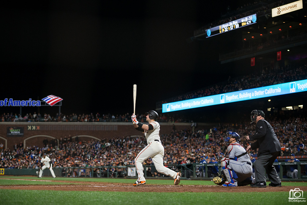 San Francisco Giants catcher Buster Posey (28) watches a fly ball against the Los Angeles Dodgers at AT&T Park in San Francisco, California, on April 24, 2017. (Stan Olszewski/Special to S.F. Examiner)