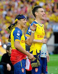 Arsenal's Alexis Sanchez and Arsenal's Olivier Giroud celebrate  - Photo mandatory by-line: Joe Meredith/JMP - Mobile: 07966 386802 - 30/05/2015 - SPORT - Football - London - Wembley Stadium - Arsenal v Aston Villa - FA Cup Final