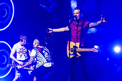 © Licensed to London News Pictures. 24/04/2014. London, UK.   McBusted performing live at The O2 Arena.  In this picture - James Bourne (left), Matt Willis (centre),Danny Jones (right).  *** LICENSE CONDITIONS USAGE ALLOWED ONLY UNTIL 14 MAY 2014, NO USAGE BEYOND THAT DATE***.  In this picture - James Bourne (left), Matt Willis (centre),Danny Jones (right). McBusted are an English pop-rock group composed of members of the bands Busted & McFly - James Bourne, Tony Fletcher, Danny Jones, Harry Judd, Dougie Poynter, and Matt Willis.  The only member of the original groups not participating in the new lineup is former Busted singer CharlieSimpson. Photo credit : Richard Isaac/LNP