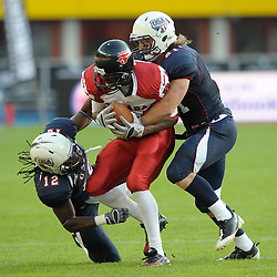 16.07.2011, Ernst Happel Stadion, Wien, AUT, American Football WM 2011, Germany (GER) vs France (FRA), im Bild Shamawd Chambers (Canada, #84, R) vs DeWayne Lewis (USA, #12, CB), Jordan Lake (USA, #21, S) // during the American Football World Championship 2011 game, Germany vs France, at Ernst Happel Stadion, Wien, 2011-07-16, EXPA Pictures © 2011, PhotoCredit: EXPA/ G. Holoubek