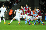 Swansea city's Ki Sung-Yueng (l) finds himself surrounded by Villa defenders. Barclays Premier league, Swansea city v Aston Villa at the Liberty Stadium in Swansea, South Wales on New Years Day, Tuesday 1st Jan 2013. pic by Andrew Orchard, Andrew Orchard sports photography,