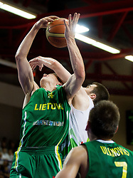 Rolandas Jakstas of Lithuania faulted by Marko Pajic of Slovenia during basketball match between National teams of Slovenia and Lithuania in First Round of U20 Men European Championship Slovenia 2012, on July 14, 2012 in Domzale, Slovenia.  (Photo by Vid Ponikvar / Sportida.com)