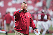 FAYETTEVILLE, AR - OCTOBER 11:  Head Coach Bret Bielema of the Arkansas Razorbacks watches his team warm up before a game against the Alabama Crimson Tide at Razorback Stadium on October 11, 2014 in Fayetteville, Arkansas.  The Crimson Tide defeated the Razorbacks 14-13.  (Photo by Wesley Hitt/Getty Images) *** Local Caption *** Bret Bielema