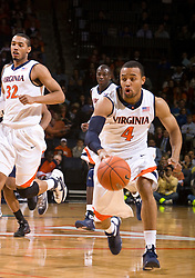 Virginia guard Calvin Baker (4) drives up court against Xavier.  The #22 ranked Xavier Musketeers defeated the Virginia Cavaliers 84-70 at the John Paul Jones Arena on the Grounds of the University of Virginia in Charlottesville, VA on January 3, 2009.