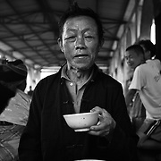 A Hmong mam eats breakfast at the weekend market in Tam Son, Ha Giang, Vietnam's northernmost province.
