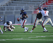 Mississippi quarterback Randall Mackey (1) rolls out to pass during a scrimmage at Vaught-Hemingway Stadium in Oxford, Miss. on Saturday, August 13, 2011. (AP Photo/Oxford Eagle, Bruce Newman)
