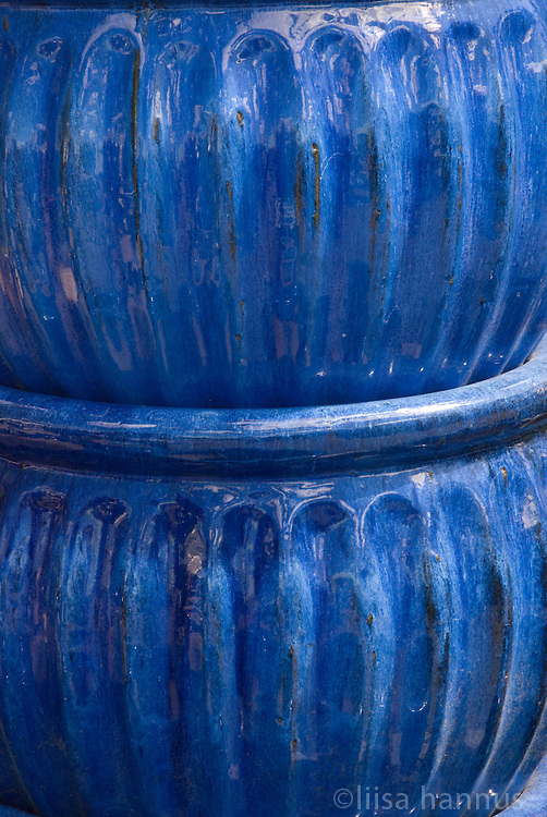 Two blue plant pots stacked