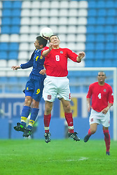 KIEV, UKRAINE - Tuesday, June 5, 2001: Wales' Neil Gibson in action against Ukraine's Armen Akopian during the Under-21 World Cup Qualifying match at the Dynamo Stadium. (Pic by David Rawcliffe/Propaganda)