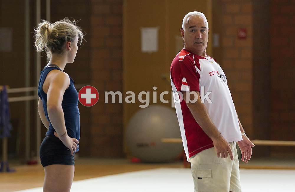 Artistic gymnastics athlete Giulia STEINGRUBER (L) of Switzerland listens to corrections from the national head coach Zoltan JORDANOV during a training session in a gym at the Federal College of Sports Magglingen in Magglingen in the canton of Berne, Switzerland, Monday, Aug. 29, 2011. (Photo by Patrick B. Kraemer / MAGICPBK)