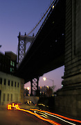 Underneath the Manhattan bridge at night