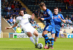 Peterborough United's Michael Bostwick in action with Rochdale's Michael Rose - Photo mandatory by-line: Joe Dent/JMP - Mobile: 07966 386802 09/08/2014 - SPORT - FOOTBALL - Rochdale - Spotland Stadium - Rochdale AFC v Peterborough United - Sky Bet League One - First game of the season