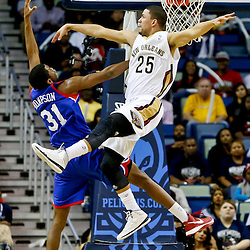 Nov 16, 2013; New Orleans, LA, USA; New Orleans Pelicans shooting guard Austin Rivers (25) fouls Philadelphia 76ers small forward Hollis Thompson (31) on a shot during the second half of a game at New Orleans Arena. The Pelicans defeated the 76ers 135-98. Mandatory Credit: Derick E. Hingle-USA TODAY Sports