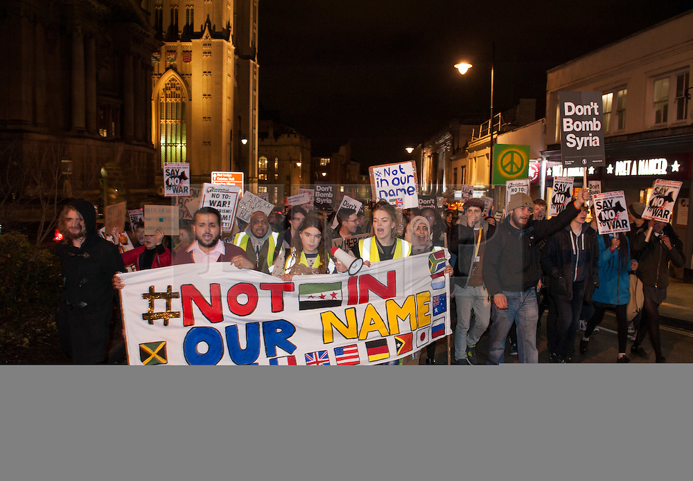 © Licensed to London News Pictures. 09/12/2015. Bristol, UK.  A Peace March predominately with young people in Bristol city centre, to demonstrate against bombing 'Islamic State', otherwise known as IS, ISIS, ISIL or Daesh in Syria. Photo credit : Simon Chapman/LNP